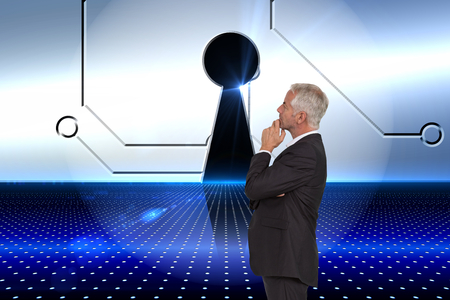 Composite image of thoughtful mature businessman posing Stock Photo