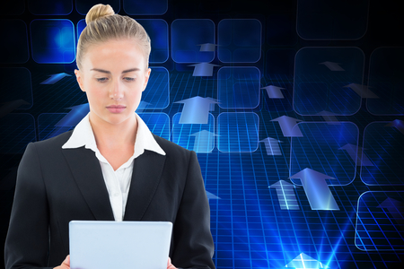 Composite image of blonde businesswoman holding tablet photo