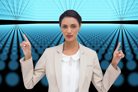 Composite image of serious businesswoman with hands up photo