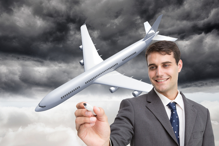 Composite image of young businessman writing something photo