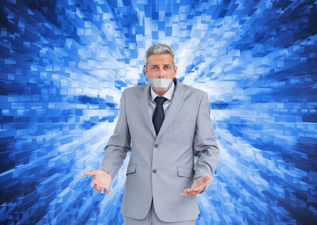 Composite image of businessman gagged with adhesive tape on mouth photo
