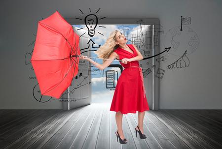 Composite image of elegant attractive blonde holding umbrella photo