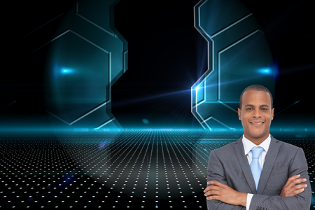 Composite image of charismatic young businessman with arms crossed photo