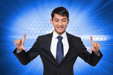 Composite image of smiling businessman holding photo