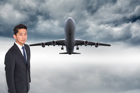 Composite image of unsmiling businessman looking at camera photo