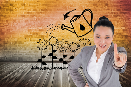 Composite image of smiling asian businesswoman pointing photo