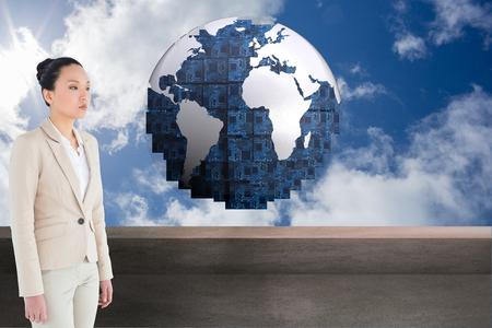 unsmiling: Composite image of unsmiling asian businesswoman walking
