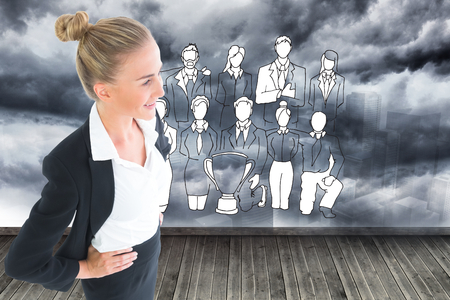 Composite image of blonde businesswoman standing with hands on hips photo