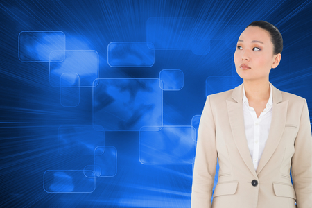 unsmiling: Composite image of unsmiling asian businesswoman Stock Photo