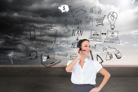 center court: Composite image of cheerful smart call center agent working while posing Stock Photo