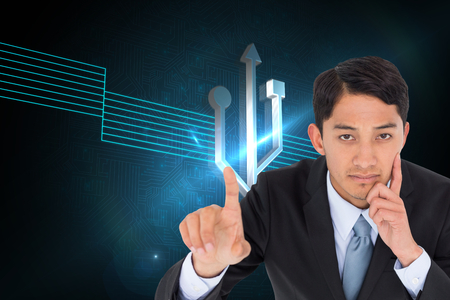 light brown hair: Composite image of thoughtful asian businessman pointing