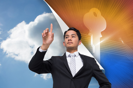 Composite image of unsmiling asian businessman pointing photo