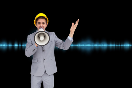 Composite image of architect with hard hat shouting with a megaphone photo