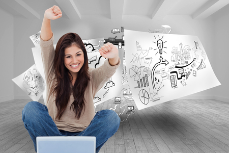 Composite image of a woman celebrating in front of her laptop as she smiles looking forward. Stock Photo