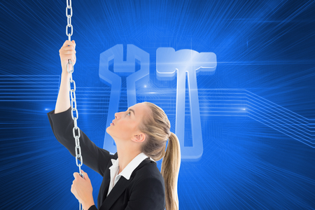 hair setting: Composite image of blonde businesswoman pulling a chain