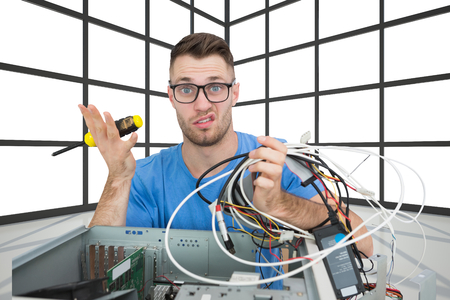 the screw driver: Composite image of portrait of confused young it professional with screw driver and cables in front of open cpu