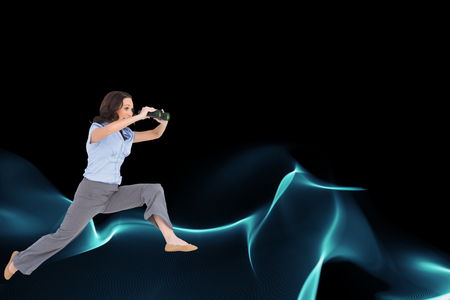 Composite image of cheerful classy businesswoman jumping while holding binoculars photo