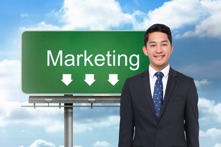 Composite image of signpost showing marketing direction with blue sky in the background photo