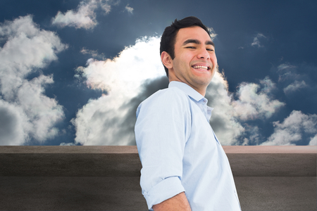 Composite image of smiling casual man standing photo