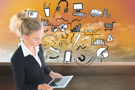 Composite image of blonde businesswoman holding new tablet photo