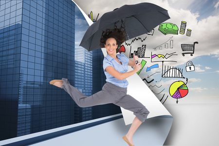 Composite image of happy classy businesswoman jumping while holding umbrella photo