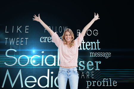 Composite image of a full length shot of a smiling woman who has her arms raised up Stock Photo - 27023097