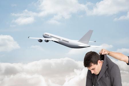 Composite image of businessman hanging photo