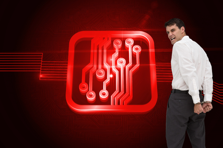 restraining: Composite image of rear view of young businessman wearing handcuffs Stock Photo