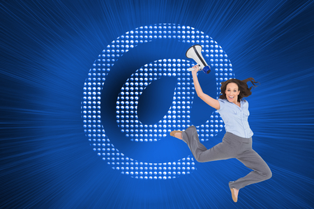 Composite image of cheerful classy businesswoman jumping while holding megaphone photo