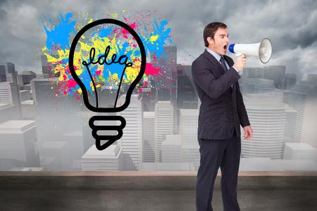 businessman using a megaphone: Composite image of standing businessman shouting through a megaphone agaisnt white Stock Photo