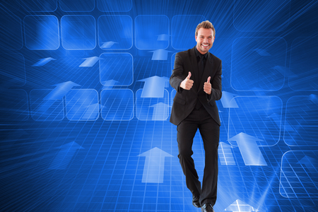 Composite image of happy businessman with thumbs up in a meeting photo