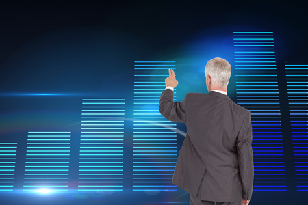 Composite image of rear view of classy mature businessman pointing finger photo