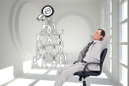 Composite image of side view of businessman leaning back in his chair photo