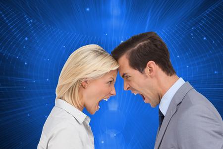 clash: Composite image of colleagues quarreling head against head