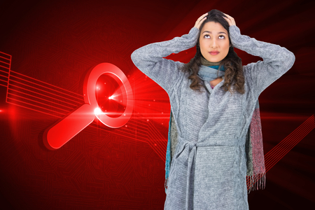 Composite image of anxious pretty brunette wearing winter clothes posing photo