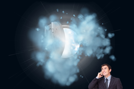 Composite image of happy attractive businessman phoning photo