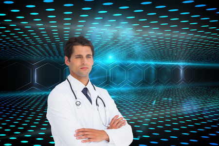 Composite image of serious doctor with arms crossed photo