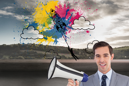 Composite image of smiling businessman holding a megaphone photo