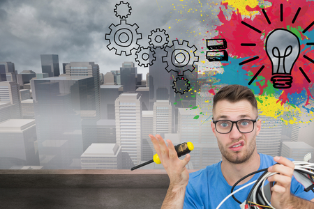 Composite image of portrait of confused young it professional with screw driver and cables in front of open cpu photo