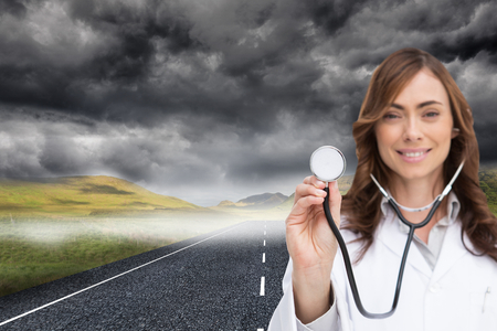 composite image: Composite image of happy brunette doctor using stethoscope