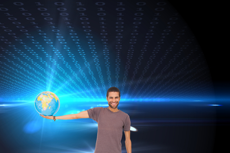 Composite image of handsome man holding out a globe photo