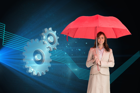 Composite image of attractive businesswoman holding red umbrella photo