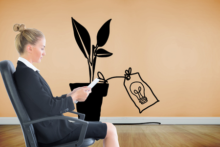Composite image of blonde businesswoman sitting on swivel chair with tablet photo