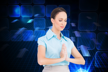 Composite image of peaceful young businesswoman praying while posing photo