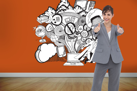 Composite image of smiling businesswoman giving thumbs up photo