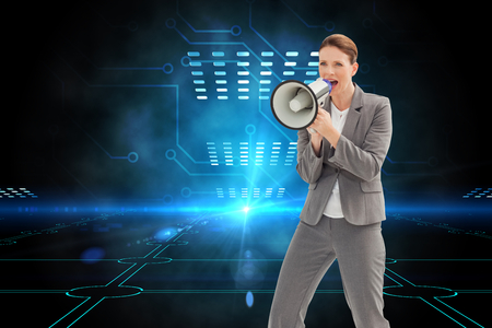 Composite image of businesswoman is talking  on a megaphone photo