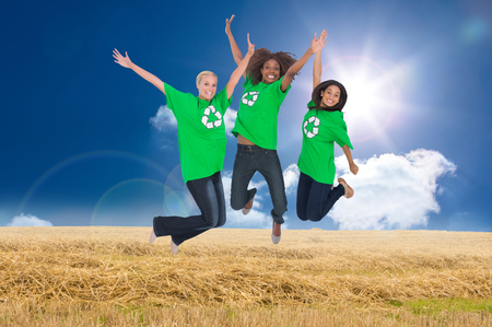 enviromental: Composite image of three enviromental activists jumping and smiling Stock Photo