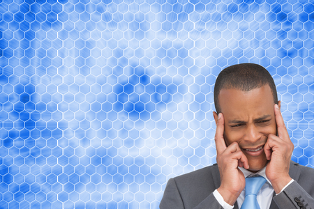 Composite image of stressed businessman putting his fingers on his temples photo