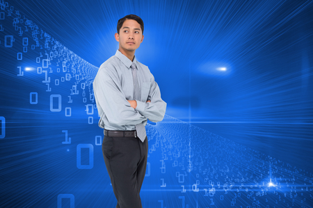 legs folded: Composite image of serious asian businessman