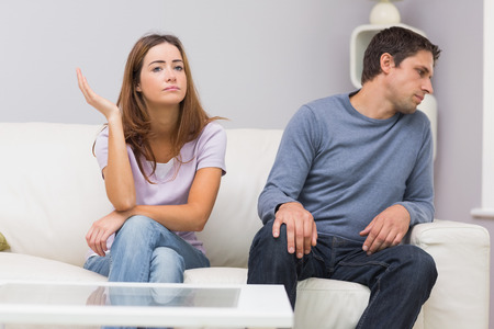 Unhappy couple not talking after argument at home on the couch photo